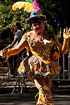 A woman dressed in a gold costume represents Bolivia in the Hispanic Parade in New York City