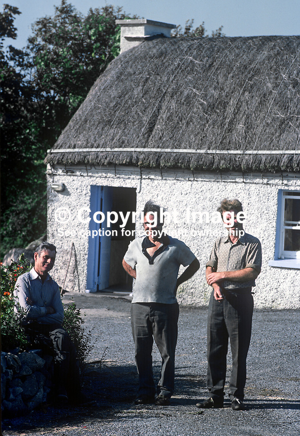 Home weavers outside their &quot;factory&quot; in Ardara, Co Donegal, Rep of Ireland. 197809000246d.<br /> <br /> Copyright Image from Victor Patterson, 54 Dorchester Park, <br /> Belfast, UK, BT9 6RJ<br /> <br /> t1: +44 28 9066 1296 (from Rep of Ireland 048 9066 1296)<br /> t2: +44 28 9002 2446 (from Rep of Ireland 048 9002 2446)<br /> m: +44 7802 353836<br /> <br /> e1: victorpatterson@me.com<br /> e2: victorpatterson@gmail.com<br /> www.victorpatterson.com<br /> <br /> Please see my Terms and Conditions of Use at www.victorpatterson.com. It is IMPORTANT that you familiarise yourself with them.<br /> <br /> Images used on the Internet must be visibly watermarked i.e. &copy; Victor Patterson<br /> within the body of the image and copyright metadata must not be deleted. Images <br /> used on the Internet have a size restriction of 4kbs and will be chargeable at current<br />  NUJ rates unless agreed otherwise.<br /> <br /> This image is only available for the use of the download recipient i.e. television station, newspaper, magazine, book publisher, etc, and must not be passed on to any third <br /> party. It is also downloaded on condition that each and every usage is notified within 7 days to victorpatterson@me.com<br /> <br /> The right of Victor Patterson to be identified as the author is asserted in accordance with The Copyright Designs And Patents Act (1988). All moral rights are asserted.