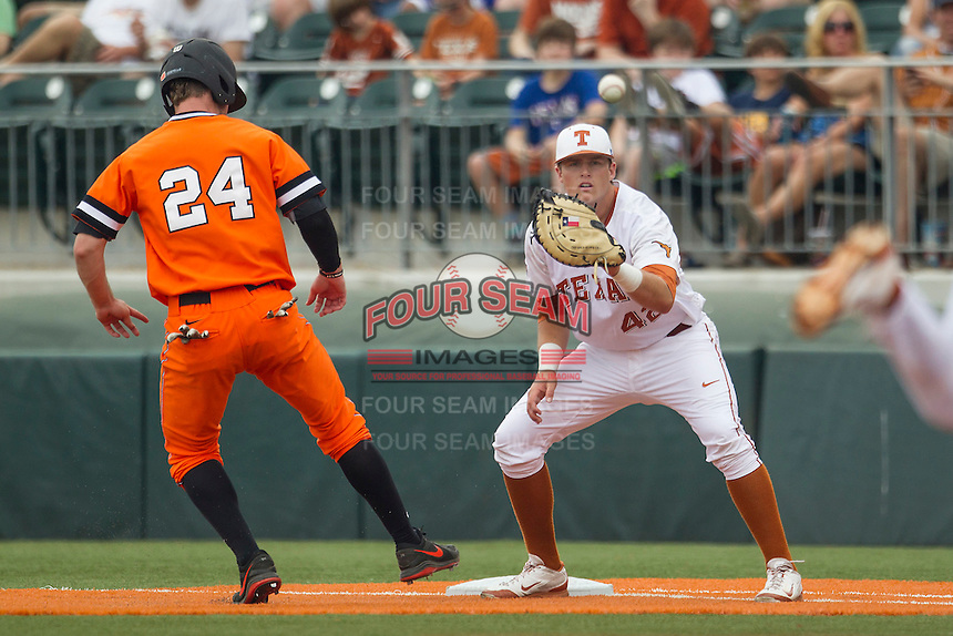 Texas Longhorns first baseman Kacy Clemens #42 catches a pickoff throw attempt at first base during the NCAA baseball game against the Oklahoma State Cowboys on April 26, 2014 at UFCU Disch–Falk Field in Austin, Texas. The Cowboys defeated the Longhorns 2-1. (Andrew Woolley/Four Seam Images)