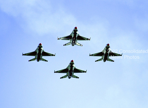 """F-16 Fighting Falcon aircraft operated by the United States Air Force """"Thunderbirds"""" perform at the Joint Base Andrews Air Show at Joint Base Andrews, Maryland on Friday, September 15, 2017. The Thunderbirds are assigned to the 57th Wing, and are based at Nellis Air Force Base, Nevada.<br /> Credit: Ron Sachs / CNP"""