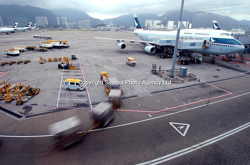 Chek lap Kok Airport, Hong Kong .Cathay Pacific planes wait on the tarmac at Hong Kong's Chep Lap Kok Airport..16-JUL-04