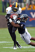 Southern Miss Golden Eagles running back Desmond Johnson (7)is tackled by Virginia Cavaliers safety Rodney McLeod (4) during the game at Scott Stadium. Virginia was defeated 30-24. (Photo/Andrew Shurtleff)