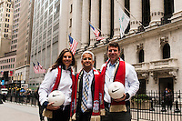 U.S. women national team midfielder Carli Lloyd, U.S. Soccer president Sunil Gulati, and former U.S. Men's National Team star Jeff Agoos pose for a photo outside the NYSE during the centennial celebration of U. S. Soccer at the New York Stock Exchange in New York, NY, on April 02, 2013.