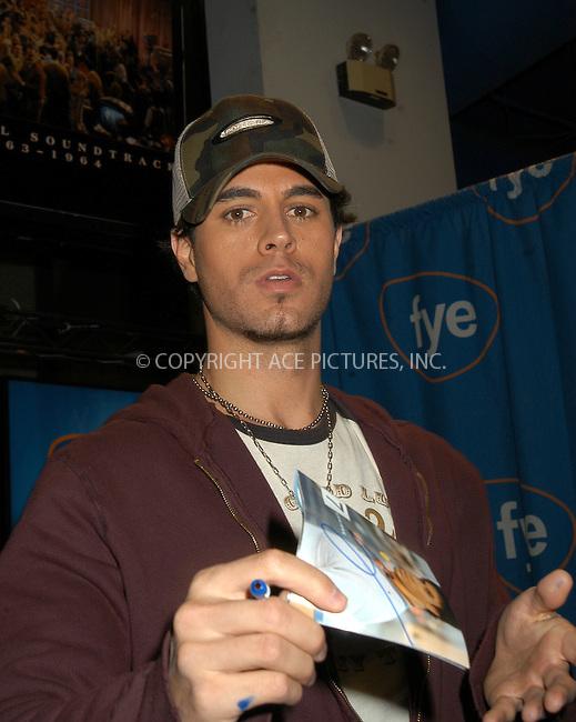 Enrique Iglesias promotes his new CD at FYI Music Store in New York. November 25, 2003. Please byline: AJ SOKLANER/NY Photo Press.   ..*PAY-PER-USE*      ....NY Photo Press:  ..phone (646) 267-6913;   ..e-mail: info@nyphotopress.com