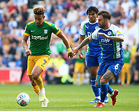 Preston North End's Callum Robinson get away from Wigan Athletic's Danny Fox<br /> <br /> Photographer David Shipman/CameraSport<br /> <br /> The EFL Sky Bet Championship - Wigan Athletic v Preston North End - Monday 22nd April 2019 - DW Stadium - Wigan<br /> <br /> World Copyright © 2019 CameraSport. All rights reserved. 43 Linden Ave. Countesthorpe. Leicester. England. LE8 5PG - Tel: +44 (0) 116 277 4147 - admin@camerasport.com - www.camerasport.com