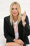 "Maria Sharapova speaks with the press during the Evian ""Live Young"" photo shoot event she hosted at Openhouse Gallery on August 24, 2010."