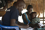 Nurse Edema Gaspar takes notes as he listens to a patient in an outreach clinic in the Rhino Refugee Camp in northern Uganda. As of April 2017, the camp held almost 87,000 refugees from South Sudan, and more people were arriving daily. About 1.8 million people have fled South Sudan since civil war broke out there at the end of 2013. About 900,000 have sought refuge in Uganda. <br /> <br /> The clinic was sponsored by Global Refuge International, which receives support from the Global Health Program of The United Methodist Church. <br /> <br /> Because of the nature of the Rhino Camp, where refugees are spread out over a wide area, it's not possible for many of them to access health care, so Global Refuge International holds outreach clinics on a regular basis through several areas of the camp.