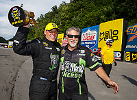 Jun 18, 2017; Bristol, TN, USA; NHRA pro stock driver Alex Laughlin (left) celebrates with father Kenny Laughlin after winning the Thunder Valley Nationals at Bristol Dragway. Mandatory Credit: Mark J. Rebilas-USA TODAY Sports