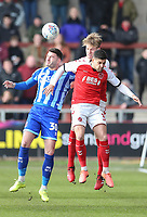 Fleetwood Town's Lewis Gibson wins a header under pressure from Blackpool's Gary Madine with Fleetwood Town's Danny Andrew close by<br /> <br /> Photographer Lee Parker/CameraSport<br /> <br /> The EFL Sky Bet League One - Fleetwood Town v Blackpool - Saturday 7th March 2020 - Highbury Stadium - Fleetwood<br /> <br /> World Copyright © 2020 CameraSport. All rights reserved. 43 Linden Ave. Countesthorpe. Leicester. England. LE8 5PG - Tel: +44 (0) 116 277 4147 - admin@camerasport.com - www.camerasport.com