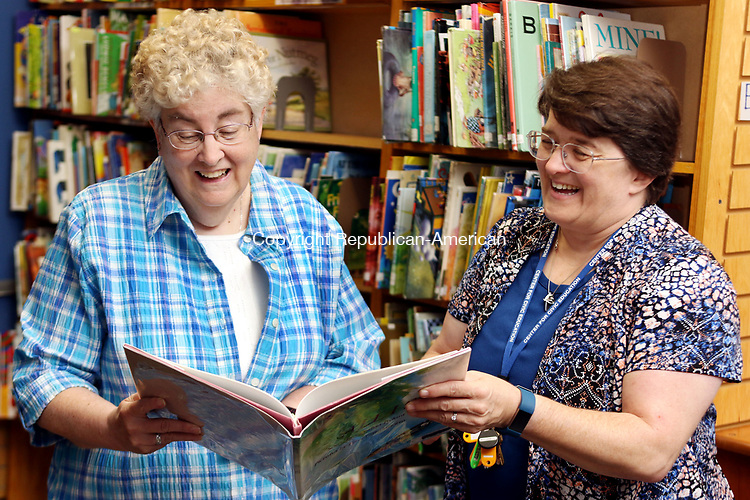 WATERBURY CT. 08 Augusr 2017-080817SV04-From left, Ellen Lynch, executive director, and Katherin Sniffin, principal, get ready for the first day of school at Children's Community School in Waterbury Tuesday.<br /> Steven Valenti Republican-American