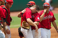 Stony Brook Seawolves pitcher Tyler Johnson #44 is hugged by his teammates following his 3 hit complete game victory at the NCAA Super Regional baseball game against LSU on June 9, 2012 at Alex Box Stadium in Baton Rouge, Louisiana. Stony Brook defeated LSU 3-1. (Andrew Woolley/Four Seam Images)