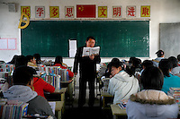 A teacher leads class in Yixing Middle School in Lianshui County, Jiangsu Province, China.  The Pfrang Association, a German charity based in Nanjing, China, sponsors a number of children in the school, providing money for boarding, food, clothing, school supplies, and other necessities to continue schooling.  The majority of children at this school come from poor farming families in rural Jiangsu Province, China.