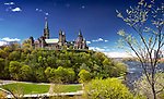 Panoramic scenery of The Parliament Hill Buildings and Ottawa river in Ottawa, Ontario, Canada on a sunny springtime day. May 2017