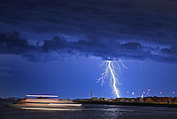 Boston, MA  -  Lightning strikes over Boston Harbor as a boat takes a cruise. Tuesday, July 24, 2012. Staff Photo by Matthew West.