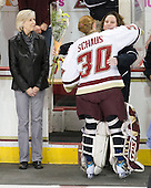 Cathy Schaus, Molly Schaus (BC - 30), Courtney Kennedy (BC - Assistant Coach) - The Boston College Eagles and the visiting University of New Hampshire Wildcats played to a scoreless tie in BC's senior game on Saturday, February 19, 2011, at Conte Forum in Chestnut Hill, Massachusetts.