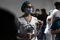 MEDELLIN, COLOMBIA - MAY 12: Nurses receive bouquets of flowers during the International Nurses Day tribute, at the Sagrado Corazón Clinic in Medellín, Colombia, on May 12, 2020. The coronavirus pandemic has claimed more than 290,000 lives worldwide, according to an account from official sources. (Photo by Fredy Builes / VIEWpress via Getty Images)