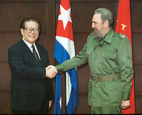 Cuban leader Fidel Castro shakes hands with Chinese President Jiang Zemin after the Chinese leader greeted the press in Spanish during photo opportunity at Havana's Palace of the Revolution April 13, 2001. Jiang Zemin is on the second day of his three-day state visit to Cuba. Credit: Jorge Rey/MediaPunch