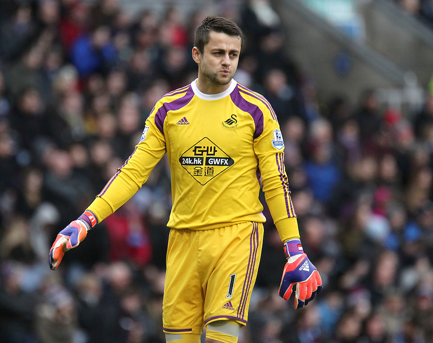 Swansea City's Lukasz Fabianski<br /> <br /> Photographer Rich Linley/CameraSport<br /> <br /> Football - Barclays Premiership - Burnley v Swansea City - Friday 27th February 2015 - Turf Moor - Burnley<br /> <br /> &copy; CameraSport - 43 Linden Ave. Countesthorpe. Leicester. England. LE8 5PG - Tel: +44 (0) 116 277 4147 - admin@camerasport.com - www.camerasport.com