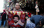 A picture taken on May 8, 2018 show an Egyptian woman  carries a pillow with a photo of Egyptian player Mohammed Salah at a market ahead of the holy Muslim month of Ramadan in Cairo, Egypt. Ramadan is sacred to Muslims because it is during that month that tradition says the Koran was revealed to the Prophet Mohammed. The fast is one of the five main religious obligations under Islam. Muslims around the world will mark the month, during which believers abstain from eating, drinking, smoking and having sex from dawn until sunset. Photo by Amr Sayed