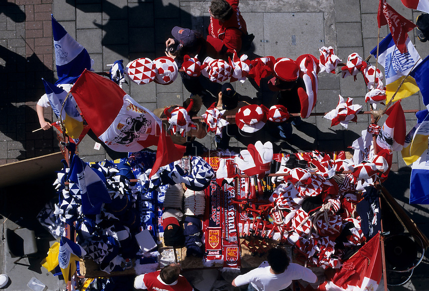 Aerial view of street vendors selling football shirts hats and scarves on match day
