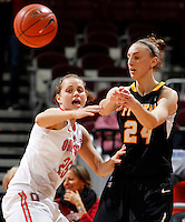 Appalachian State Mountaineers forward Maryah Sydnor (24) throws a pass past Ohio State Buckeyes guard Amy Scullion (25) during the first half of the NCAA women's basketball game between the Ohio State Buckeyes and the Appalachian State Mountaineers at Value City Arena in Columbus, Ohio, on Friday, Dec. 20, 2013. At the half, the Buckeyes trailed the Mountaineers 21-17. (Columbus Dispatch/Sam Greene)