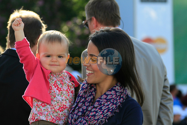 Diane Donald and baby Elle wait for Luke to go into a playoff with Lee Westwood (ENG) at the end of the Final Day of the BMW PGA Championship at Wentworth Club, Surrey, England, 29th May 2011. (Photo Eoin Clarke/Golffile 2011)