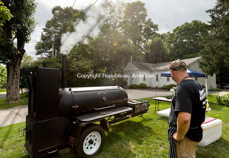 Roxbury, CT- 18 July 2015-071815CM02-  Todd Snowden of Litchfield, waits as smoke billows out of a smoker during the annual family barbecue at Christ Church in Roxbury on Saturday. Snowden smoked up chicken and ribs and served them with baked beans and cole slaw for the attendees.  Proceeds from the event will go towards the church.    Christopher Massa Republican-American