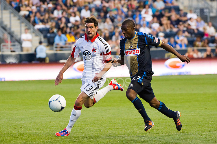 Chris Pontius (13) of DC United is defended by Michael LaHoud (13) of the Philadelphia Union. DC United defeated Philadelphia Union 1-0 during a Major League Soccer (MLS) match at PPL Park in Chester, PA, on June 16, 2012.