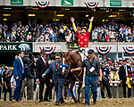 ELMONT, NY - JUNE 09: -  Mike Smith celebrates winning the 150th Belmont Stakes, becoming the 13 Triple Crown champion at Belmont Park on June 09, 2018 in Elmont, New York. (Photo by Alex Evers/Eclipse Sportswire/Getty Images)