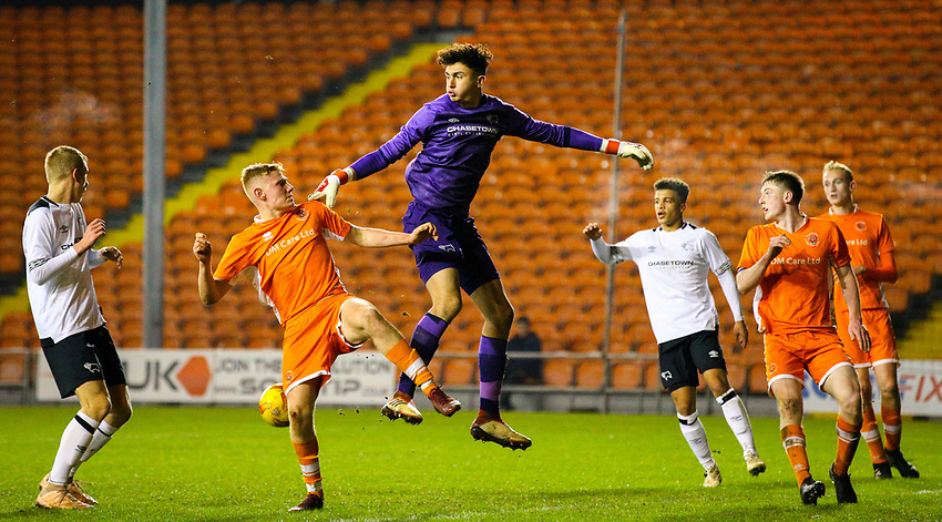 Blackpool's Owen Watkinson battles with Derby County's Bradley Foster-Theniger<br /> <br /> Photographer Alex Dodd/CameraSport<br /> <br /> The FA Youth Cup Third Round - Blackpool U18 v Derby County U18 - Tuesday 4th December 2018 - Bloomfield Road - Blackpool<br />  <br /> World Copyright © 2018 CameraSport. All rights reserved. 43 Linden Ave. Countesthorpe. Leicester. England. LE8 5PG - Tel: +44 (0) 116 277 4147 - admin@camerasport.com - www.camerasport.com
