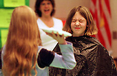 "A drum roll please:  An elementary school student (name omitted) helps to raise money for charity by taking a pie in the face. ""I didn't like the waiting part"", she said."