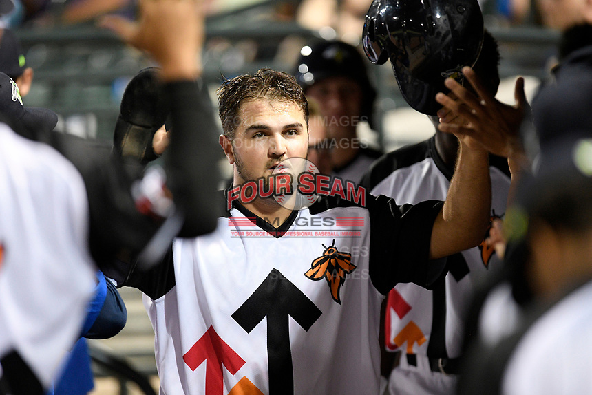 First baseman Chase Chambers (8) of the Columbia Fireflies is greeted after scoring a run in a game against the Lexington Legends on Thursday, June 13, 2019, at Segra Park in Columbia, South Carolina. Lexington won, 10-5. (Tom Priddy/Four Seam Images)