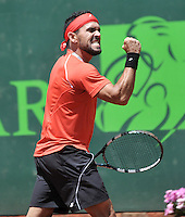 BOGOTA - COLOMBIA -10 -11-2013: Victor Estrella, tenista de Republica Dominicana, celebra tras ganar partido de la final del Seguros Bolivar Open en el Club Campestre el Rancho de la ciudad de Bogota. / Victor Estrella, Republica Dominicana, tennis player celebrates winning match  during the finals of the Seguros Bolivar Open in the Club Campestre El Rancho in Bogota city. Photo: VizzorImage  / Luis Ramirez / Staff.