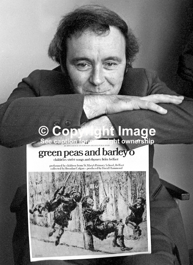 """David Hammond, writer, singer, teacher, songwriter, historian, musician, film-maker, broadcaster, Belfast, N Ireland, with one of his LPs of local street songs titled  """"green peas and barley o"""". 197504000337c..Copyright Image from Victor Patterson, 54 Dorchester Park, Belfast, United Kingdom, UK...For my Terms and Conditions of Use go to http://www.victorpatterson.com/Victor_Patterson/Terms_%26_Conditions.html"""