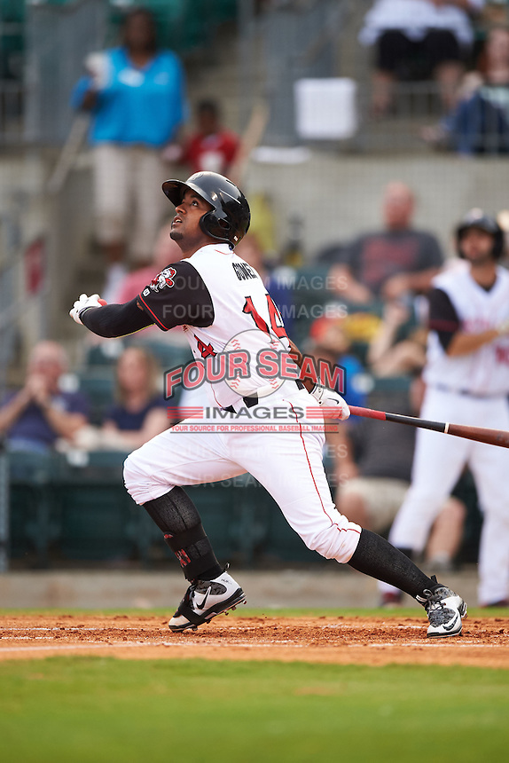 Arkansas Travelers catcher Raywilly Gomez (14) at bat during a game against the Corpus Christi Hooks on May 29, 2015 at Dickey-Stephens Park in Little Rock, Arkansas.  Corpus Christi defeated Arkansas 4-0 in a rain shortened game.  (Mike Janes/Four Seam Images)