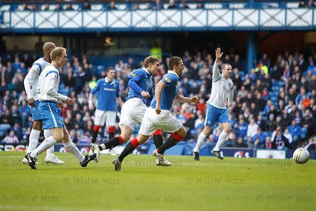 Nikica Jelavic turns in the opening goal