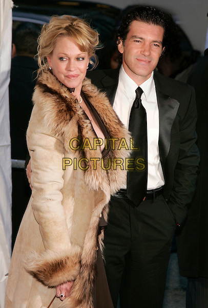 "MELANIE GRIFFITH & ANTONIO BANDERAS .The World Premiere of ""Take the Lead"" at Lowes Lincoln Square Theatre, New York, NY, USA..April 4th, 2006.Photo: Jackson Lee/Admedia/Capital Pictures.Ref: JL/ADM.headshot portrait.half length celebrity couple married husband wife black jacket brown beige fur coat.www.capitalpictures.com.sales@capitalpictures.com.© Capital Pictures."