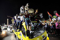 People play music and wave flags in the air as they celebrate at Martys' Square in Tripoli. After a six month revolution, rebel forces finally managed to break into Tripoli and have taken control of Bab al-Aziziyah, Col Gaddafi's compound and residence. Few remain that are loyal to Gaddafi in the city; it is seeming that the 42 year regime has come to an end. Gaddafi is currently on the run.