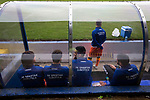 Visiting team players sitting in the away dugout during the pre-match warm-up before Coleraine played Spartak Subotica of Serbia in a Europa League Qualifying First Round second leg at the Showgrounds, Coleraine. The hosts from Northern Ireland had drawn the away leg 1-1 the previous week, however, the visitors won the return leg 2-0 to progress to face Sparta Prague in the next round, watched by a sell-out crowd of 1700.