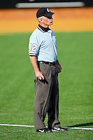 Umpire Thomas Baldinelli during the Atlantic Coast Conference game between the Miami Hurricanes and the Wake Forest Demon Deacons at Gene Hooks Field on March 19, 2011 in Winston-Salem, North Carolina.  Photo by Brian Westerholt / Four Seam Images