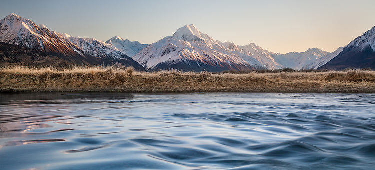 Panoramic view of a winter sunrise looking across the Tasman River towards Aoraki / Mount Cook covered in snow, Mackenzie Country, Canterbury, New Zealand - stock photo, canvas, fine art print