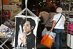 July 23, 2010 - Tokyo, Japan - Japanese women look at commercial posters and products featuring South Korean celebrities, near JR Shin-okubo station in Tokyo, Japan, on July 23, 2010. Japanese fans of South Korean actor and singer Park Yong-ha, who commits suicide on June 30th, visited a memorial altar set up at a Korean restaurant in Tokyo's Okubo district, where many Koreans live.