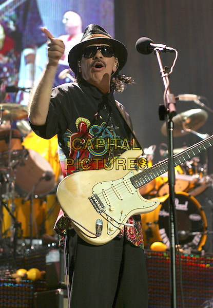 SANTANA.Performs in concert at Madison Square Garden in New York City..June 15th, 2005.stage live concert music gig performance half length guitar hat sunglasses shades pointing .www.capitalpictures.com.sales@capitalpictures.com.©Capital Pictures