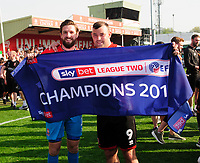 Lincoln City's Josh Vickers, left, and Matt Rhead celebrate securing the League 2 Tilte<br /> <br /> Photographer Andrew Vaughan/CameraSport<br /> <br /> The EFL Sky Bet League Two - Lincoln City v Tranmere Rovers - Monday 22nd April 2019 - Sincil Bank - Lincoln<br /> <br /> World Copyright © 2019 CameraSport. All rights reserved. 43 Linden Ave. Countesthorpe. Leicester. England. LE8 5PG - Tel: +44 (0) 116 277 4147 - admin@camerasport.com - www.camerasport.com
