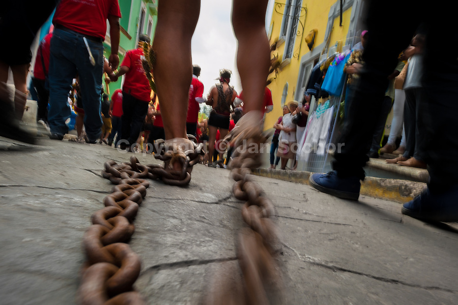A Catholic penitent drags chains, attached to his legs, during the Holy week procession in Atlixco, Mexico, 30 March 2018. Every year on Good Friday, dozens of anonymous men of all ages voluntarily undergo pain and suffering during the religious procession of the 'Engrillados' (the Shackled ones) in Puebla state, central Mexico. Wearing heavy chains on their shoulders covered with prickling cacti while being burned by the hot midday sun, they recall Jesus Christ's death by crucifixion and demonstrate their religiosity and faith.