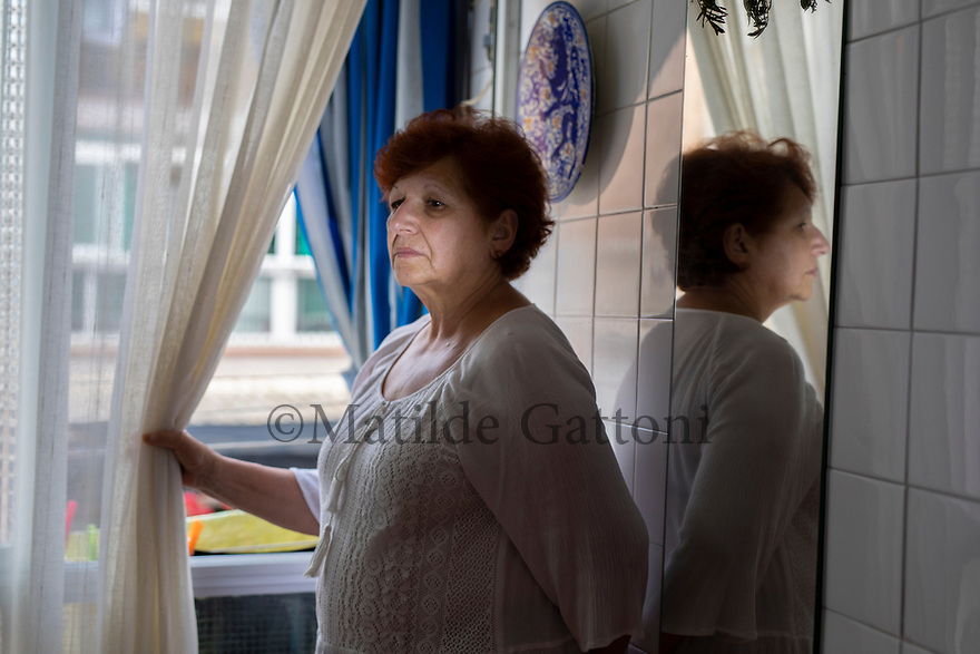 """Spain - L'Hospitalet De Llobregat - Portrait of Maria Isabel Morera Amaya, 70. Maria Isabel Morera Amaya never spoke about the child she had lost in July 1973. The words uttered by a nun at that time - """"pray God he dies if you don't want a retarded, blind son"""" - had marked her beyond belief."""