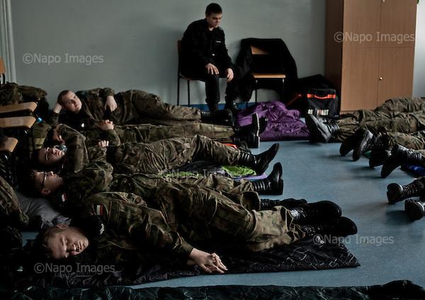 KALISZ, 7/03/2015:<br /> W ten weekend czlonkowie organizacji zebrali sie w lokalnym liceum ogolnoksztalcacym na dwudniowe cwiczenia. Od rozpoczecia wojny na Ukrainie rozne organizacje paramilitarne staja sie coraz bardziej popularne.<br /> Fot: Piotr Malecki<br /> <br /> KALISZ, POLAND, MARCH 7, 2015:<br /> Young members of &quot;Strzelec&quot; (&quot;The Shooter&quot;) paramilitary association and of local classes with military profile, rest during the break in training. This weekend a few paramilitary groups from this region of Poland are having their trainining session, their base being a secondary school number 5 in Kalisz.<br /> Since the start of war in Ukraine, paramilitary associations are becoming more popular.<br /> (Photo by Piotr Malecki)