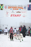 Charley Bejna and team leave the ceremonial start line at 4th Avenue and D street in downtown Anchorage during the 2013 Iditarod race. Photo by Jim R. Kohl/IditarodPhotos.com