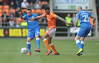 Blackpool's Curtis Tilt is tackled by Peterborough United's Lee Tomlin<br /> <br /> Photographer Kevin Barnes/CameraSport<br /> <br /> The EFL Sky Bet League One - Blackpool v Peterborough United - Saturday 13th April 2019 - Bloomfield Road - Blackpool<br /> <br /> World Copyright &copy; 2019 CameraSport. All rights reserved. 43 Linden Ave. Countesthorpe. Leicester. England. LE8 5PG - Tel: +44 (0) 116 277 4147 - admin@camerasport.com - www.camerasport.com