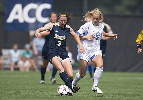 September 01, 2013:  Notre Dame midfielder Morgan Andrews (3) controls the ball as  UCLA defender Abby Dahlkemper (8) defends during NCAA Soccer match between the Notre Dame Fighting Irish and the UCLA Bruins at Alumni Stadium in South Bend, Indiana.  UCLA defeated Notre Dame 1-0.